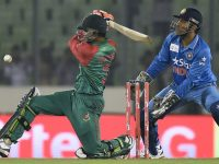 Bangladesh cricketer Taskin Ahmed (L) plays a shot as Indian crikcet captain Mahendra Singh Dhoni looks on during the Asia Cup T20 cricket match between India and Bangladesh at Sher-e-Bangla National Cricket Stadium in Dhaka on February 24, 2016. / AFP / MUNIR UZ ZAMAN        (Photo credit should read MUNIR UZ ZAMAN/AFP/Getty Images)